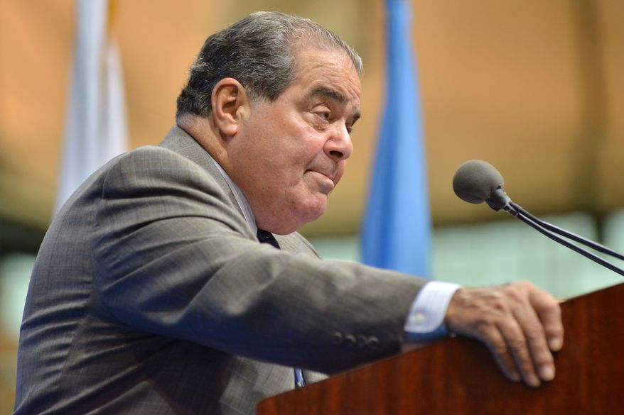 Supreme Court Justice Antonin Scalia pauses during a speech as part of a lecture series at Tufts University on Wednesday, Oct. 2, 2013, in Medford, Mass.  Justice Scalia, who has served on the nation's highest court since 1986 following a nomination by President Reagan, spoke about interpreting the U.S. Constitution. (AP Photo/Josh Reynolds)