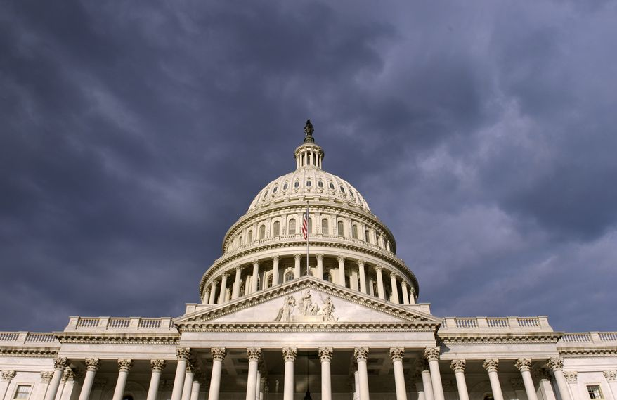 ** FILE ** In this Tuesday, Oct. 1, 2013, file photo, dark clouds pass over the Capitol in Washington. (AP Photo/Susan Walsh, File)