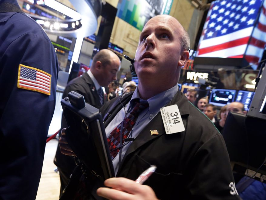 Trader Kevin Walsh works on the floor of the New York Stock Exchange Wednesday, Oct. 2, 2013. The stock market is opening lower as the U.S. government shutdown enters a second day with little hope for a resolution in sight. (AP Photo/Richard Drew)