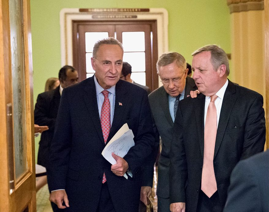 Sen. Charles Schumer of New York, Senate Majority Leader Harry Reid of Nevada and Senate Majority Whip Richard Durbin of Illinois arrive for a news conference. Mr. Reid see that House Republicans are the obstacle to ending the government shutdown.