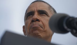 President Barack Obama speaks about the government shutdown and debt ceiling during a visit to M. Luis Construction, which specializes in asphalt manufacturing, concrete paving, and roadway reconstruction, in Rockville, Md., Thursday, Oct. 3, 2013. (AP Photo/Charles Dharapak)