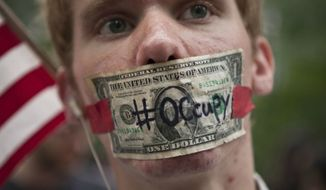 "** FILE ** An ""Occupy Wall Street"" protester in Zuccotti Park in New York, Oct. 10, 2011. (AP Photo/Andrew Burton)"