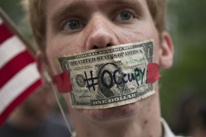"""** FILE ** An """"Occupy Wall Street"""" protester in Zuccotti Park in New York, Oct. 10, 2011. (AP Photo/Andrew Burton)"""
