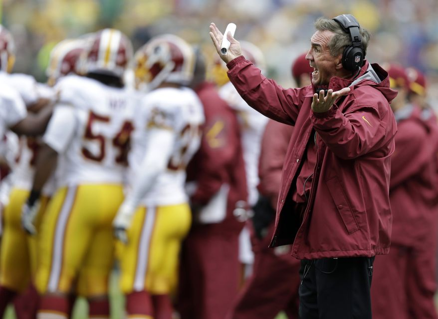 ADVANCE FOR WEEKEND EDITIONS, OCT. 5-6 - FILE - In this Sept. 15, 2013, file photo, Washington Redskins head coach Mike Shanahan argues a call during the first half of an NFL football game against the Green Bay Packers in Green Bay, Wis. Barely a day goes by in which a Redskins player or coach doesn't reference the fact that they were a miserable 3-6 at their bye week in 2012, and how they emerged from the break a different team by winning seven straight to claim the NFC East title.  The comparisons are inevitable, because this year's bye already has arrived and the Redskins are again struggling. They are 1-3. (AP Photo/Tom Lynn, File)