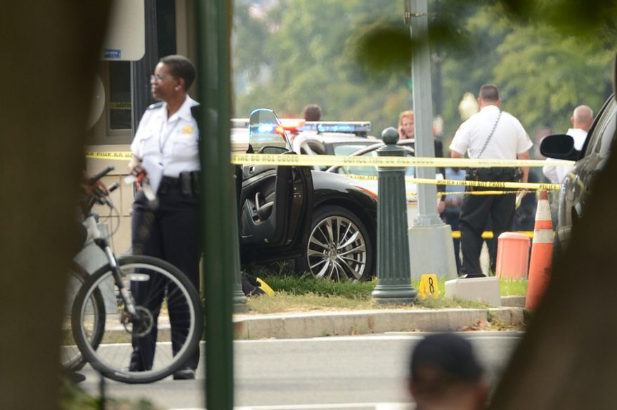This black vehicle was allegedly the car police were chasing when they cornered it at 1st Street and Constitution Ave. NE in front of the Hart Office Building near the U.S. Capitol Building, Washington, D.C., Thursday, October 3, 2013. (Andrew Harnik/The Washington Times)