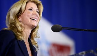 State Sen. Wendy Davis, D-Fort Worth, speaks at a rally Thursday, Oct. 3, 2013, in Haltom City, Texas, where she formally declared her candidacy for governor of Texas. (AP Photo/The Daily Texan, Charlie Pearce)