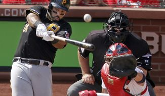 Pittsburgh Pirates' Pedro Alvarez (24) hits a two-run home run against the St. Louis Cardinals in the third inning of Game 2 of baseball's National League division series on Friday, Oct. 4, 2013, in St. Louis. Catching for the Cardinals is Yadier Molina. (AP Photo/Sarah Conard)