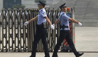 ** FILE ** Chinese police officers. (Associated Press)