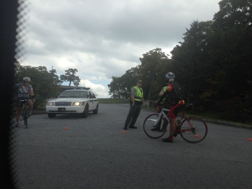 Park rangers on Friday were turning away people who want to visit the Pisgah Inn on the Blue Ridge Parkway in an effort to enforce the National Park Service's decision to shut down the private establishment during the government shutdown. A Times reader sent in photos of the rangers blocking the entrance. (Image provided by Sloane Salzman)