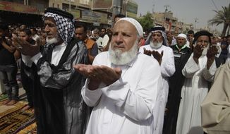 Followers of Shiite cleric Muqtada al-Sadr attend Friday prayers in the predominantly Shiite neighborhood of Sadr City in Baghdad on Friday, Oct. 4, 2013. (AP Photo/Karim Kadim)