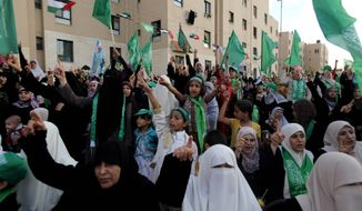 ** FILE ** Supporters of the Islamic militant group Hamas attend a rally in Beit Lahia, northern Gaza Strip, on Friday, Oct. 4, 2013. Hamas, which is sworn Israel's destruction, has ruled Gaza since 2007, when it ousted forces loyal to the secular Palestinian group Fatah. (AP Photo/Hatem Moussa)
