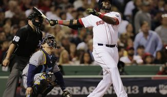 Boston Red Sox designated hitter David Ortiz watches his second home run of the game off Tampa Bay Rays starting pitcher David Price, in front of Rays catcher Jose Molina in the eighth inning in Game 2 of baseball's American League division series Saturday, Oct. 5, 2013, in Boston.  (AP Photo/Charles Krupa)