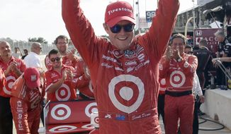 Scott Dixon, of New Zealand, celebrates after winning the first IndyCar Grand Prix of Houston auto race, Saturday, Oct. 5, 2013, in Houston. (AP Photo/David J. Phillip)