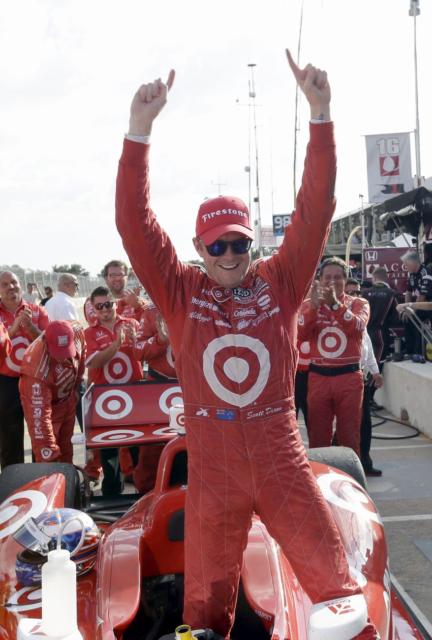 Scott Dixon, of New Zealand, celebrates after winning the first IndyCar Grand Prix of Houston auto race, Saturday, Oct. 5, 2013, in Houston. (AP Photo/David J. Phillip)