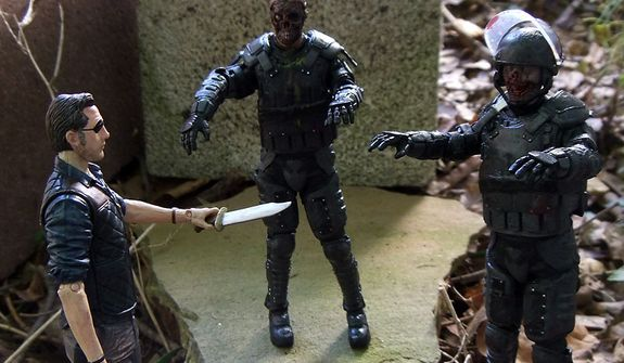 The Governor is surrounded by Riot Gear Gas Mask Zombie and Riot Gear Zombie from McFarlane Toys' The Walking Dead TV Series 4 action figure collection.