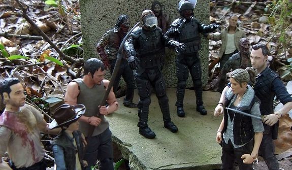 The Governor threatens Andrea while Rick, Carl, Daryl, Merle and some hungry zombies look on in McFarlane Toys' The Walking Dead TV Series action figure collection. (Photo by Joseph Szadkowski/The Washington Times)