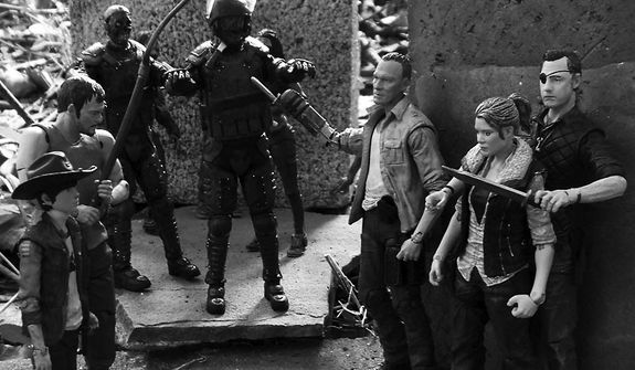 The Governor threatens Andrea as Merle keeps zombies away while Carl and Daryl, look on in McFarlane Toys' The Walking Dead TV Series action figure collection. (Photo by Joseph Szadkowski/The Washington Times)