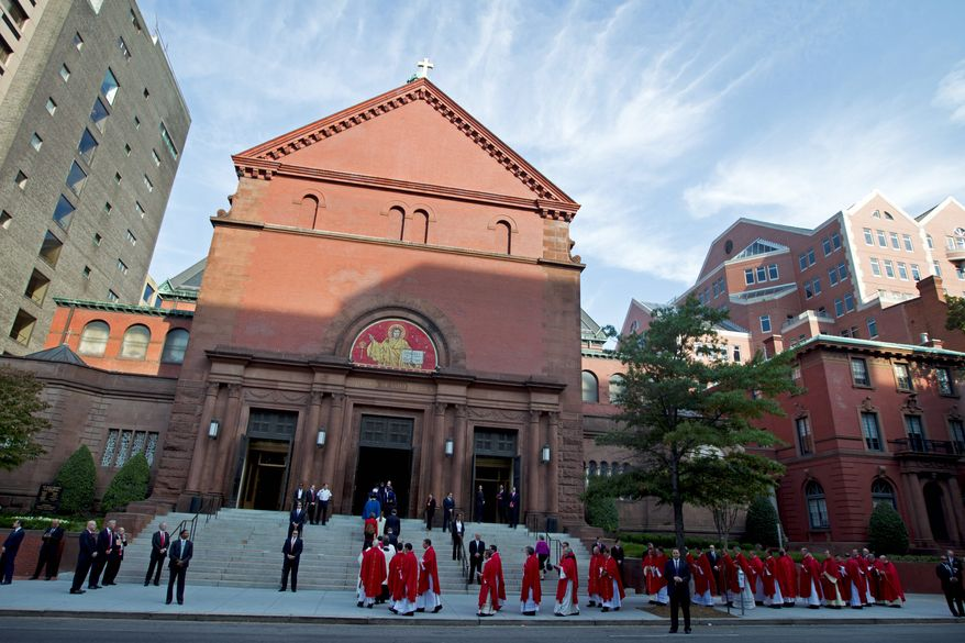 Members of the clergy walk into the Cathedral of St. Matthew the Apostle in the District of Columbia before the 61st annual Red Mass in this Sunday, Oct. 6, 2013, file photo. (Associated Press) ** FILE **