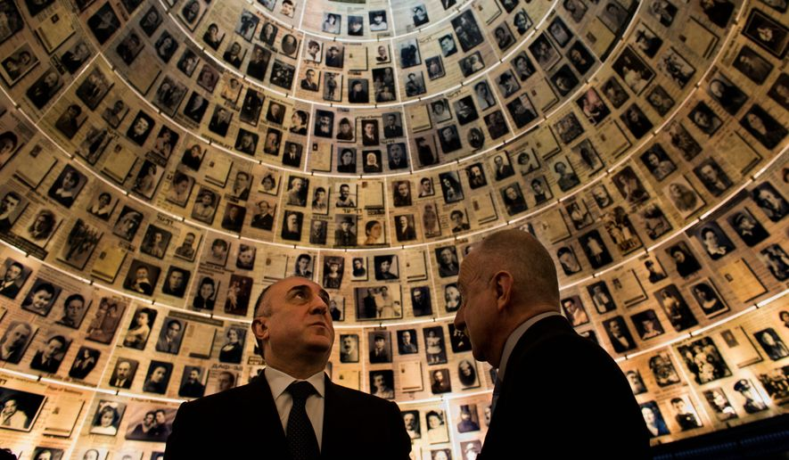Azerbaijan's Foreign Minister Elmar Mammadyarov (left) visits the Hall of Names at the Yad Vashem Holocaust memorial in Jerusalem in April. Israel's president praised Azerbaijan earlier this year for playing a key role in countering Iran's influence in the Middle East as the Muslim country's foreign minister visited the Jewish state for the first time. (Associated Press)