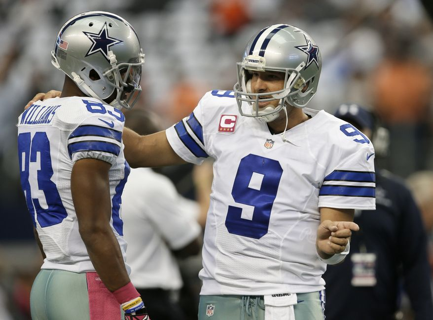 Dallas Cowboys wide receiver Terrance Williams (83) talks with quarterback Tony Romo (9) as they warm up before an NFL football game against the Denver Broncos, Sunday, Oct. 6, 2013, in Arlington, Texas. The Broncos won 51-48. (AP Photo/Tony Gutierrez)