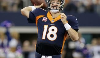 Denver Broncos quarterback Peyton Manning (18) passes during the fourth quarter of an NFL football game against the Denver Broncos, Sunday, Oct. 6, 2013, in Arlington, Texas. The Broncos won 51- 48. (AP Photo/Tony Gutierrez)