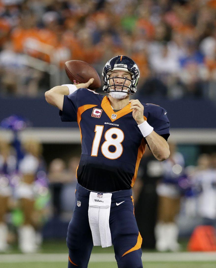 Denver Broncos quarterback Peyton Manning (18) passes during the fourth quarter of an NFL football game against the Denver Broncos, Sunday, Oct. 6, 2013, in Arlington, Texas. The Broncos won 51- 48. (AP Photo/Tony Gutierrez)
