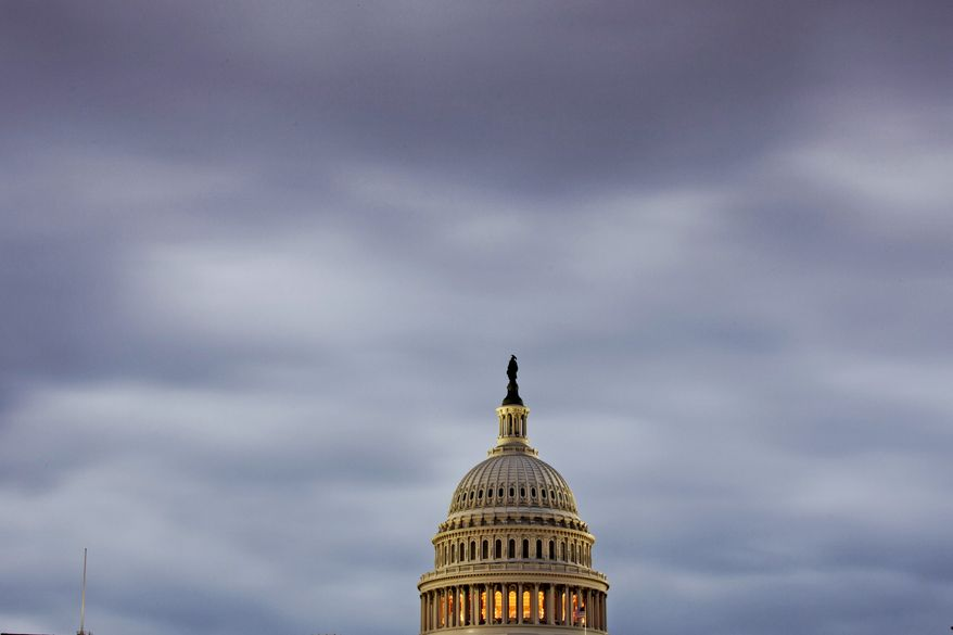 The Capitol in Washington is seen under an overcast sky at dawn, Monday, Oct. 7, 2013.  The government shutdown entered its second week with no end in sight and ominous signs that the United States was closer to the first default in the nation's history as Speaker John Boehner ruled out any measure to boost borrowing authority without concessions from President Barack Obama.  (AP Photo/J. Scott Applewhite)