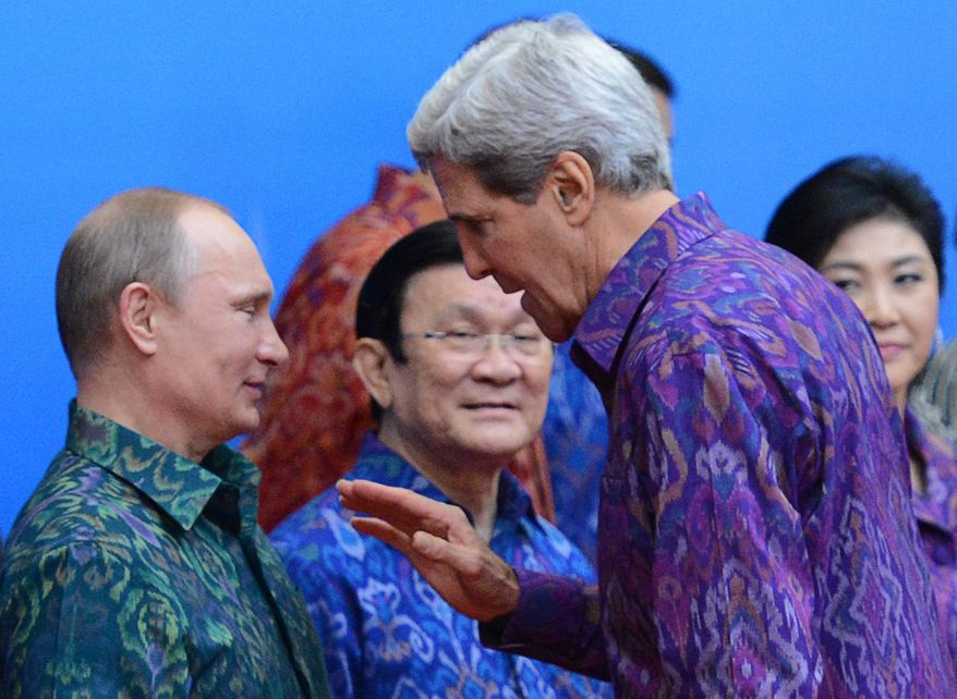 United States Secretary of State John Kerry, right, speaks with Russian President Vladimir Putin during a Family Photo at the Asia-Pacific Economic Cooperation (APEC) summit in Bali, Indonesia, Monday, Oct. 7, 2013. (AP Photo/The Canadian Press, Sean Kilpatrick)