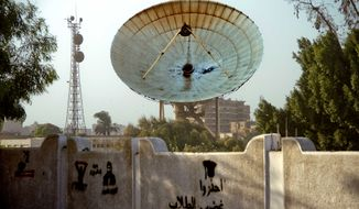 "A satellite dish stands damaged after at least two rocket propelled grenades slammed into a compound housing the country's main satellite earth station in the Maadi district of Cairo, Egypt, Monday, Oct. 7, 2013. The wall in the foreground bears Arabic graffiti reading ""beware of the students' anger."" The attack came a day after dozens were killed when holiday celebrations marking the start of the 1973 Mideast war turned into deadly clashes across Egypt, though it was not immediately clear if Monday's violence was related.(AP Photo/Hamada Elrasam)"