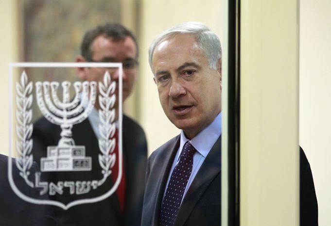 Israeli Prime Minister Benjamin Netanyahu arrives to deliver joint statements with Czech Republic President Milos Zeman in Jerusalem on Monday, Oct. 7, 2013. (AP Photo/Baz Ratner, Pool)