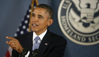 """President Barack Obama makes a statement about the government shutdown during a visit to the Federal Emergency Management Agency (FEMA) headquarters in Washington, Monday, Oct. 7, 2013. The president thanked workers at the FEMA for doing their jobs under """"less than optimal circumstances"""" during the government shutdown.  (AP Photo/Charles Dharapak)"""
