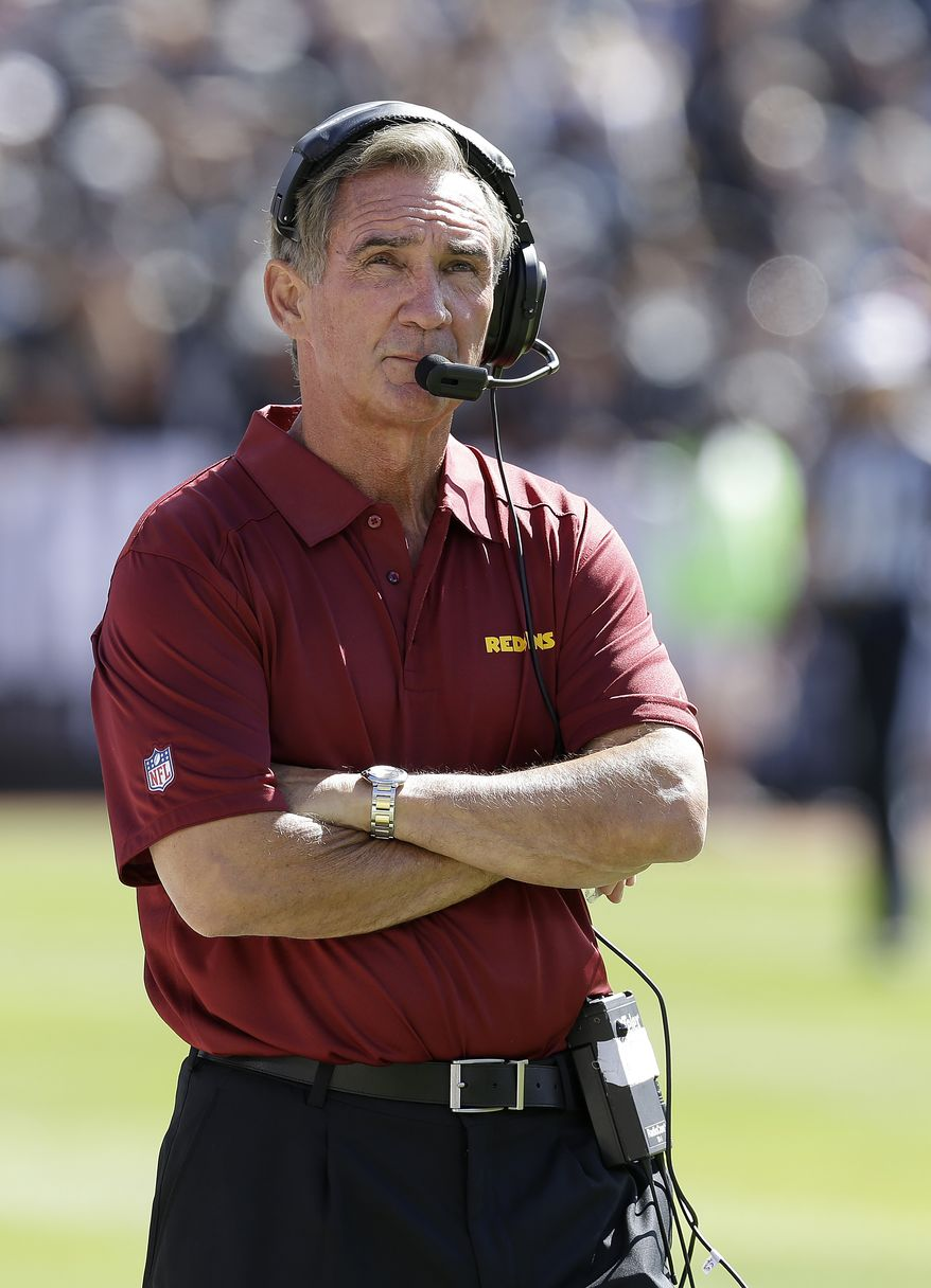 Washington Redskins head coach Mike Shanahan against the Oakland Raiders during the first half of an NFL football game in Oakland, Calif., Sunday, Sept. 29, 2013. (AP Photo/Ben Margot)