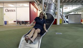 State Senator Wendy Davis, who is running for Texas Governor, takes the slide on a tour of Rackspace Hosting Inc. Monday Oct. 7, 2013 in San Antonio. (AP Photo/San Antonio Express-News, Edward A. Ornelas) MAGS OUT NO SALES SAN ANTONIO OUT