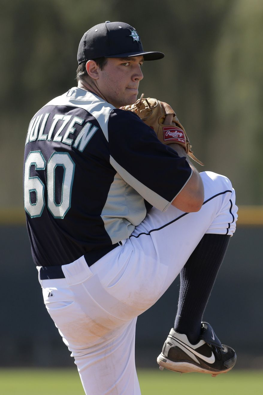 Seattle Mariners pitcher Danny Hultzen throws during a baseball spring training workout Tuesday, Feb. 19, 2013, in Peoria, Ariz. (AP Photo/Charlie Riedel)