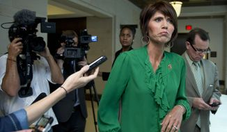 **FILE** House Armed Services Committee member Kristi Noem, South Dakota Republican, arrives Sept. 9, 2013, on Capitol Hill for a closed-door meeting on Syria. (Associated Press)