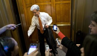 Sen. Tom Coburn, R-Okla., is pursued by members of the media as he gets on an elevator on Capitol Hill in Washington, Tuesday, Oct. 8, 2013, after leaving a Republican policy luncheon. (AP Photo/Evan Vucci)