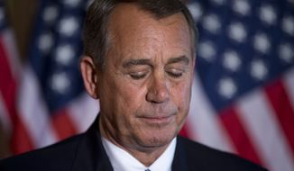 House Speaker John Boehner of Ohio pauses while speaking about the ongoing budget battle, Tuesday, Oct. 8, 2013, outside his office on Capitol Hill  in Washington. (AP Photo/ Evan Vucci)