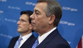 ** FILE ** House Speaker John Boehner of Ohio, right, and House Majority Leader Eric Cantor of Va., participate in a news conference after a House Republican conference meeting, on Capitol Hill in Washington, Tuesday, Oct. 8, 2013.  (AP Photo/ Evan Vucci)