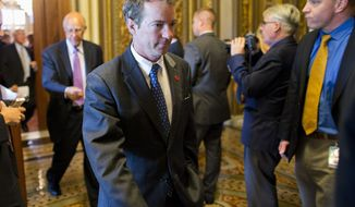 Sen. Rand Paul, R-Ky. walks to the Senate floor on Capitol Hill in Washington, Tuesday, Oct. 8, 2013, after leaving a Republican policy luncheon. House Republicans floated broad hints Tuesday they might be willing to pass short-term legislation re-opening the government and averting a default in exchange for immediate talks with the Obama administration on reducing deficits and changing the three-year-old health care law.   (AP Photo/ Evan Vucci)