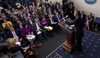 """President Barack Obama talks about the the budget and the partial government shutdown, Tuesday, Oct. 8, 2013, in the Brady Press Room of the White House in Washington. The president said he told House Speaker John Boehner he's willing to negotiate with Republicans on their priorities, but not under the threat of """"economic chaos.""""  (AP Photo/Pablo Martinez Monsivais)"""