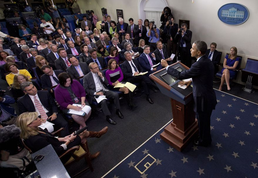 "President Barack Obama talks about the the budget and the partial government shutdown, Tuesday, Oct. 8, 2013, in the Brady Press Room of the White House in Washington. The president said he told House Speaker John Boehner he's willing to negotiate with Republicans on their priorities, but not under the threat of ""economic chaos.""  (AP Photo/Pablo Martinez Monsivais)"