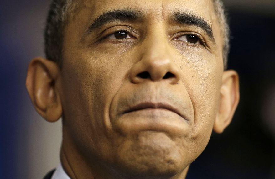 """President Barack Obama pauses as he talks about the the budget and the partial government shutdown, Tuesday, Oct. 8, 2013, in the Brady Press Room of the White House in Washington. The president said he told House Speaker John Boehner he's willing to negotiate with Republicans on their priorities, but not under the threat of """"economic chaos.""""  (AP Photo/Pablo Martinez Monsivais)"""