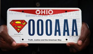 "State representative Bill Patmon holds the new Superman license plate that will be available from the Bureau of Motor Vehicles on Oct. 7, 2013 in Cleveland. Ohio fans of the Man of Steel now officially can have the Superman logo on their wheels. A license plate with the iconic ""S'' insignia and the phrase ""Truth, Justice and the American Way"" went on sale Monday. Relatives of Superman creators Jerry Siegel and Joe Shuster were on hand for the plate's unveiling outside the Cleveland-area home where Siegel lived, The plates cost $20, plus the standard registration fee of $34.50 or the typical $16.25 in fees to replace existing plates. Part of the fee goes to the Siegel and Shuster Society, which commemorates the men's work.  Patmon was responsible for introducing legislation for the license plate in the Ohio House.  (AP Photo/The Plain Dealer, Gus Chan) MANDATORY CREDIT; NO SALES"