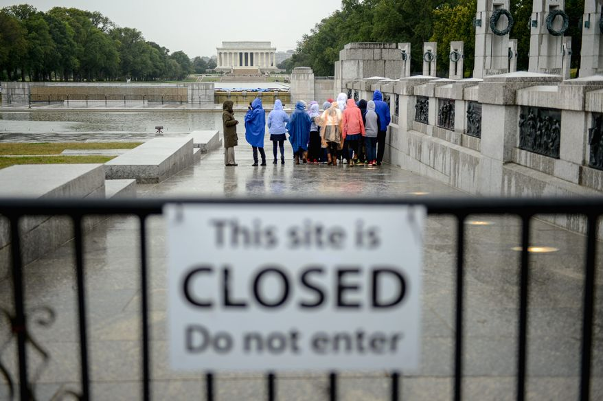 Students from Barnhart School in Arcadia, Calif., visit the World War II Memorial on the Mall on Wednesday, though the memorials are technically closed because of an ongoing government shutdown. (Andrew Harnik/The Washington Times)