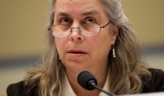 "Sarah Hall Ingram, director of the Affordable Care Act Office at the Internal Revenue Service, told a House committee Wednesday that she was ""not conscious of ever sharing 6103 data information at the White House."" She said the agency is keeping Obamacare applicants' information private. She also said she had ""no recollection"" of hearing about IRS targeting of conservatives. (ASSOCIATED PRESS)"