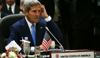 U.S. Secretary of State John Kerry attends the 1st Association of Southeast Asian Nations (ASEAN) - U.S. Summit in Bandar Seri Begawan, Brunei, Wednesday, Oct. 9, 2013. (AP Photo/Vincent Thian)