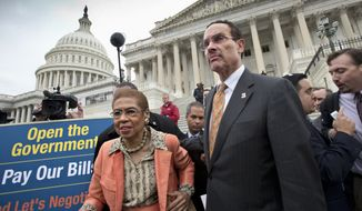 Washington Mayor Vincent Gray, right, and Del. Eleanor Holmes Norton, D-D.C., left, make their way through the crowd after joining Senate Democrats outside the Capitol in Washington, Wednesday, Oct. 9, 2013, to urge House Speaker John Boehner of Ohio, and other House Republicans, to break the impasse on a funding bill and stop the government shutdown that is now in its second week. Gray said in a statement Tuesday that the shutdown, now in its second week, is having dire consequences in his city. He said D.C. is the only city in the country where residents are worried that their local government won't be able to provide basic services during the shutdown.  (AP Photo/J. Scott Applewhite)
