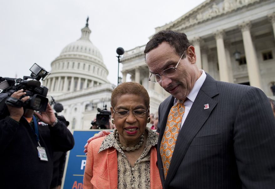 Washington, Mayor Vincent Gray, right, Del. Eleanor Holmes Norton, D-D.C., left, make their way through the crowd after joining Senate Democrats outside the Capitol in Washington, Wednesday, Oct. 9, 2013, to urge House Speaker John Boehner of Ohio, and other House Republicans, to break the impasse on a funding bill and stop the government shutdown that is now in its second week. Gray said in a statement Tuesday that the shutdown, now in its second week, is having dire consequences in his city. He said D.C. is the only city in the country where residents are worried that their local government won't be able to provide basic services during the shutdown. (AP Photo/ Evan Vucci)