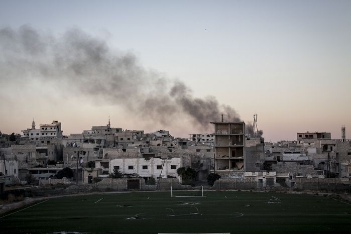 Smoke rises after a mortar shell hits a residential area during fighting between Syrian government forces and rebels in Maaret al-Numan in the Idlib province, Syria, Wednesday, Oct. 9, 2013. Rebels Wednesday overran a military post near the southern city of Daraa, according to the Britain-based Syrian Observatory for Human Rights activist group. Opposition fighters late last month also captured a nearby military base that previously served as the customs office on the outskirts of Daraa. (AP Photo)