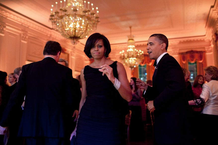 President Barack Obama and First Lady Michelle Obama dance together during the Governors Ball in the East Room of the White House, Feb. 21, 2010. (Official White House Photo by Pete Souza)